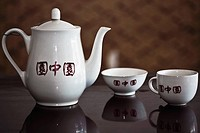 Close_up of a teapot with teacups, HohHot, Inner Mongolia, China