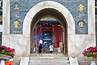 Tourists at the entrance of a temple, Zhanshan Temple, Qingdao, Shandong Province, China