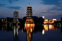 Pagodas at the waterfront, Sun and Moon Pagoda, Banyan Lake, Guilin, Guangxi Province, China