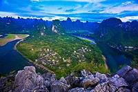 High angle view of a river passing through mountains, Li River, XingPing, Yangshuo, Guangxi Province, China