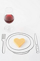 Heart-shaped cheese on drawing of plate, glass of red wine nearby