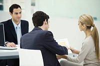 Professional meeting with clients, couple analyzing document together (thumbnail)