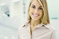 Customer service representative smiling at camera, portrait