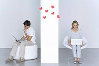 Man and woman using laptop computers, hearts floating in the air between them (thumbnail)