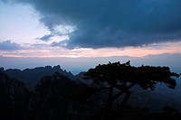 Silhouette of a mountain range at dusk, Huangshan Mountains, Anhui Province, China