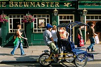 England _ London _ Soho district _ people walking by restaurant at Leicester Square