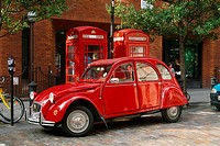 England _ London _ red vintage car parked by telephone booths