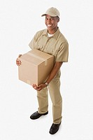 Mixed race delivery man holding cardboard box