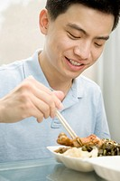 Close_up of a male office worker having lunch