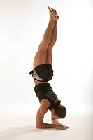 Man performing yoga handstand