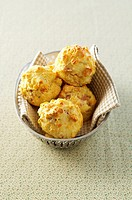 Four Parmesan muffins in a bread basket