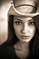 Portrait of young woman in cowboy hat