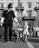 milan, policeman help a little girl to crossing the street, 1967