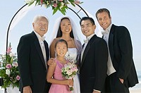 Bride and Groom with best man and family outdoors portrait
