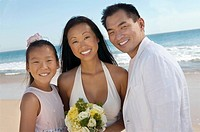 Bride and Groom with sister on beach portrait