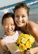 Flower girl and Bride at ocean portrait