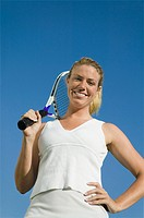 Female tennis player Holding Tennis Racket portrait low angle view