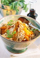 Exotic rice with curry powder, apricots and almonds