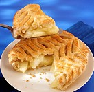 Apple pie with puff pastry crust, a piece on server