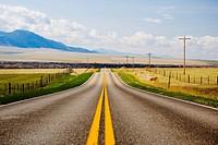 Road passing through fields, Montana, USA