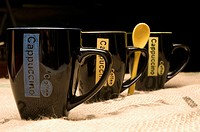 Close_up of coffee cups in a row