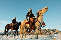 Cowboys out for a ride in winter, Shell, Wyoming, USA
