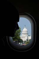 Passenger looking at a building through the window of an airplane, Capitol Building, Washington DC, USA