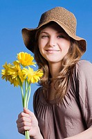 Portrait of a teenage girl holding bunch of flowers