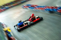 High angle view of two people go_carting on a motor racing track