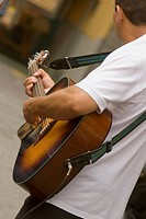 Side profile of a man playing guitar, Via Padre Reginaldo Giuliani, Sorrento, Sorrentine Peninsula, Naples Province, Campania, Italy