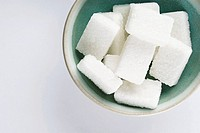 High angle view of a bowl of sugar cubes