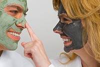 Close-up of a mature couple wearing facial masks and smiling (thumbnail)