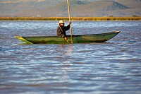 Side profile of a senior man fishing in a lake