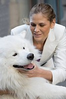 Close_up of a businesswoman playing with her dog