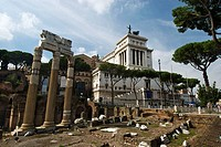 Corinthian columns on Julius Caesar«s forum with the monument to Vittorio Emanuele II at background  Via dei Fori Imperiali  Rome, Lazio, Italy