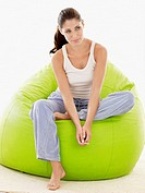 Young woman sitting on beanbag portrait