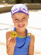 Girl in swimming costume holding medal portrait