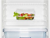 Salad box in fridge close_up