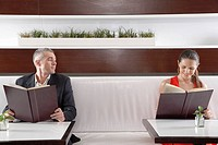 Woman and man with menus flirting