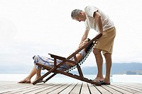 Mature couple relaxing on deck