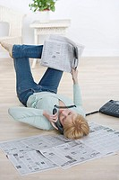 Woman on phone lying on back