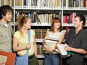 Group of young people in a library (thumbnail)