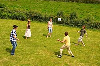 Group of five people playing football (thumbnail)
