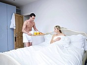 Man and woman in bedroom