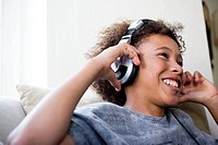 Boy with big earphones enjoying music