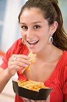 Teenage Girl Eating French Fries