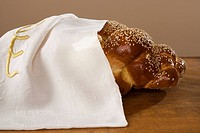 Loaf of Challah bread under cloth