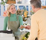 Female florist ringing up customer
