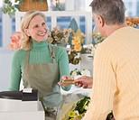 Female florist ringing up customer