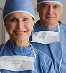 Portrait of senior male and female surgeons